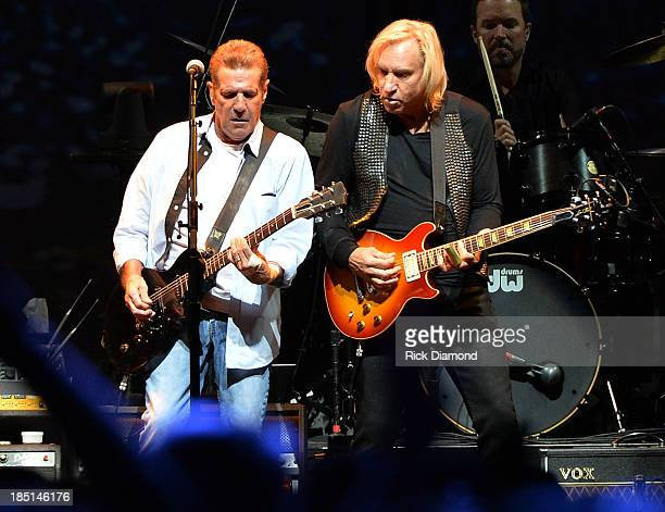 Glen Frey and Joe Walsh of the Eagles perform during History Of The Eagles Live In Concert at the Bridgestone Arena on October 16 2013 in Nashville Tn