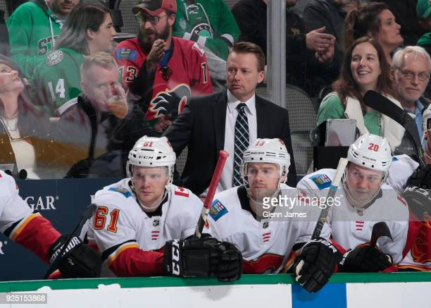Glen Gulutzan head coach of the Calgary Flames watches the action from the bench against the Dallas Stars at the American Airlines Center on February...