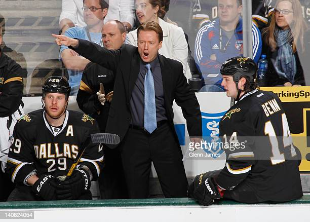 Glen Gulutzan head coach of the Dallas Stars directs his team from the bench against the Pittsburgh Penguins at the American Airlines Center on...