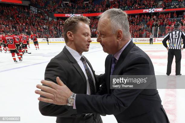 Glen Gulutzan of the Calgary Flames shakes hands with Randy Carlyle of the Anaheim Ducks after Game Four of the Western Conference First Round during...