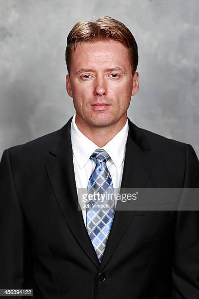 Glen Gulutzan of the Vancouver Canucks poses for his official headshot for the 201415 NHL season on September 18 2014 at Rogers Arena in Vancouver...