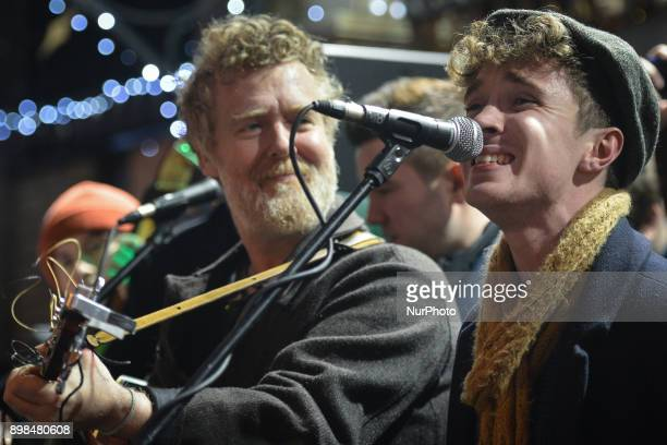Glen Hansard and David Keenan take part in the annual Christmas Eve busk in aid of the Dublin Simon Community outside the Gaiety Theater in Dublin...
