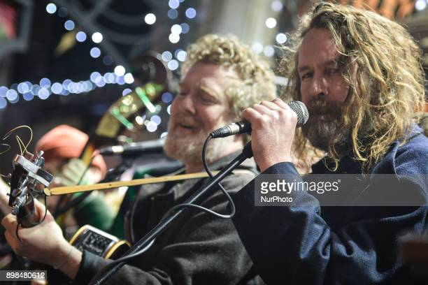Glen Hansard and Liam O Maonlai take part in the annual Christmas Eve busk in aid of the Dublin Simon Community outside the Gaiety Theater in Dublin...