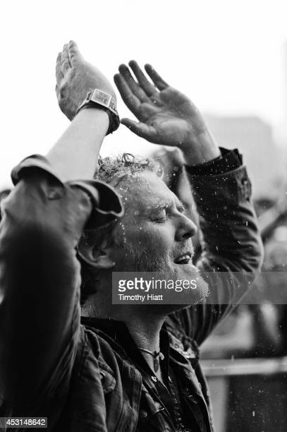 Glen Hansard braves the rain with fans at Lollapalooza 2014 at Grant Park on August 3 2014 in Chicago Illinois