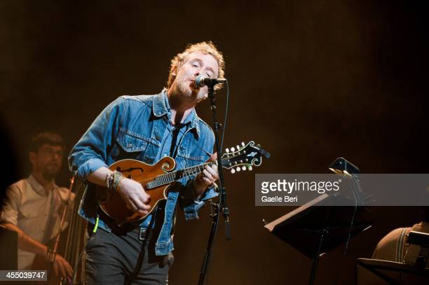 Glen Hansard performs on stage with Calexico for Holiday Cheer For FUV 2013 at Beacon Theatre on December 10 2013 in New York New York