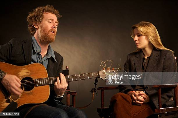 – Glen Hansard sings and Mark·ta Irglov waiting for her part of song during studio interview at the Los Angeles Times via Getty Images Interview of...