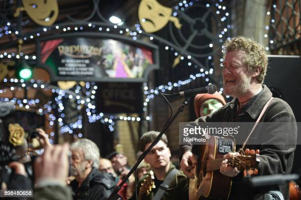 Glen Hansard takes part in the annual Christmas Eve busk in aid of the Dublin Simon Community outside the Gaiety Theater in Dublin Hundreds attended...