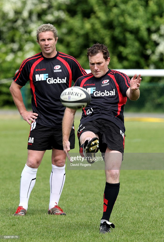 Glen Jackson kicks the ball upfield watched by Justin Marshall during the Saracens training session on May 25, 2010 in St Albans, England.