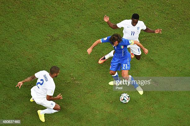 Glen Johnson and Danny Welbeck of England close down Andrea Pirlo of Italy during the 2014 FIFA World Cup Brazil Group D match between England and...