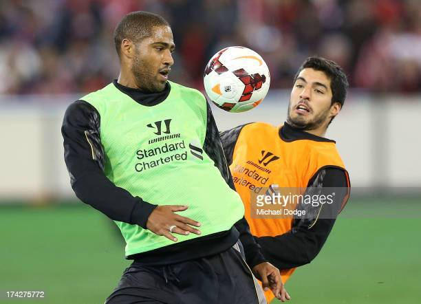 Glen Johnson and Luis Suarez contest for the ball during a Liverpool FC training session at Melbourne Cricket Ground on July 23, 2013 in Melbourne,...