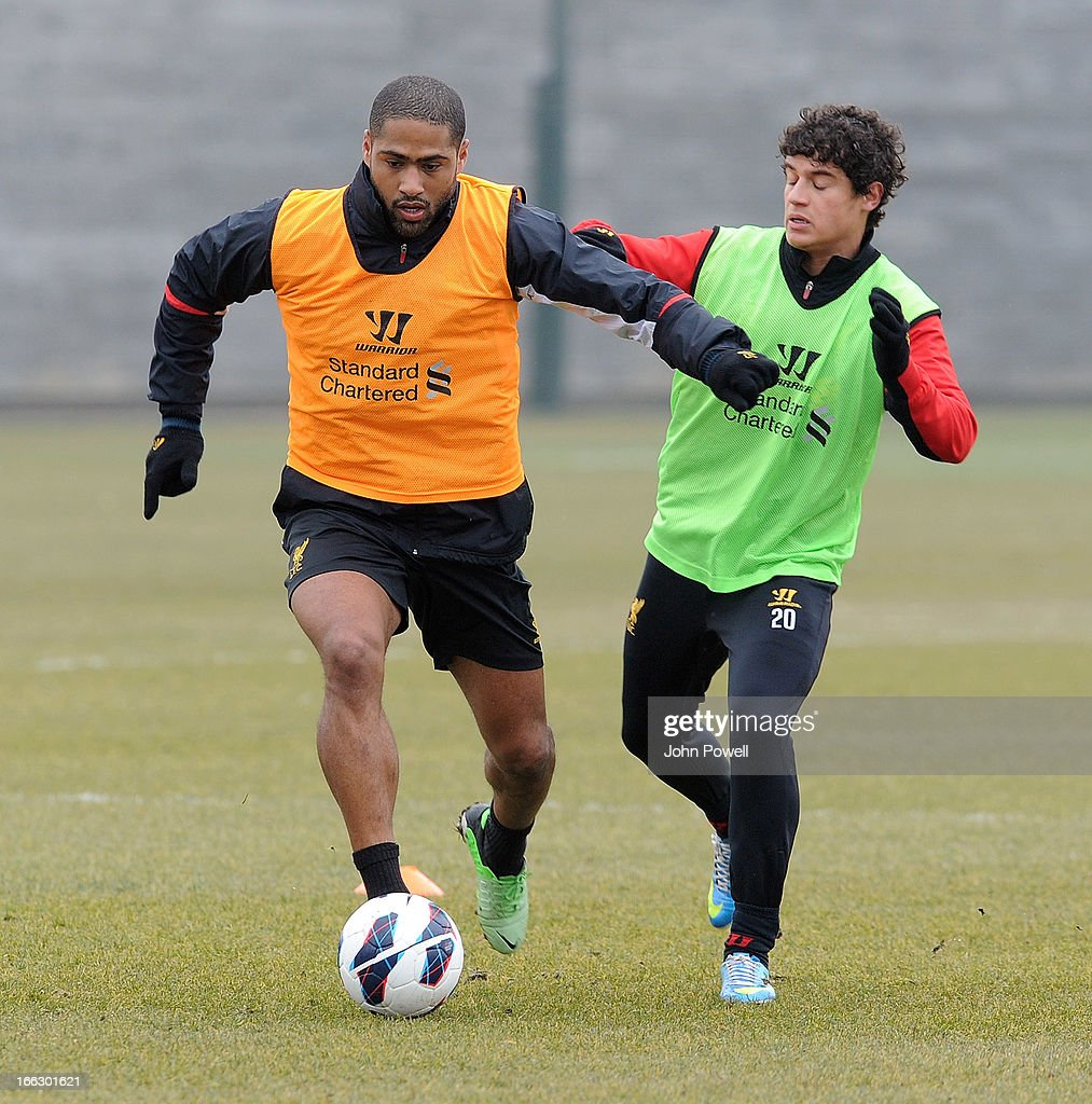 Glen Johnson and Phillipe Coutinho of Liverpool in action during a training session at Melwood Training Ground on April 11, 2013 in Liverpool, England.