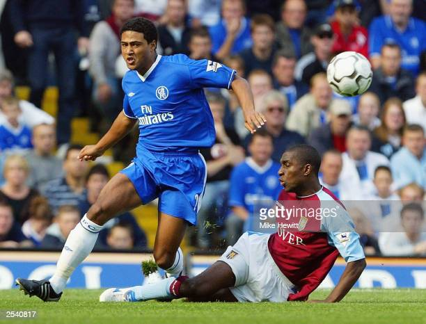 Glen Johnson of Chelsea battles with Jlloyd Samuel of Aston Villa during the FA Barclaycard Premiership match between Chelsea and Aston Villa at...