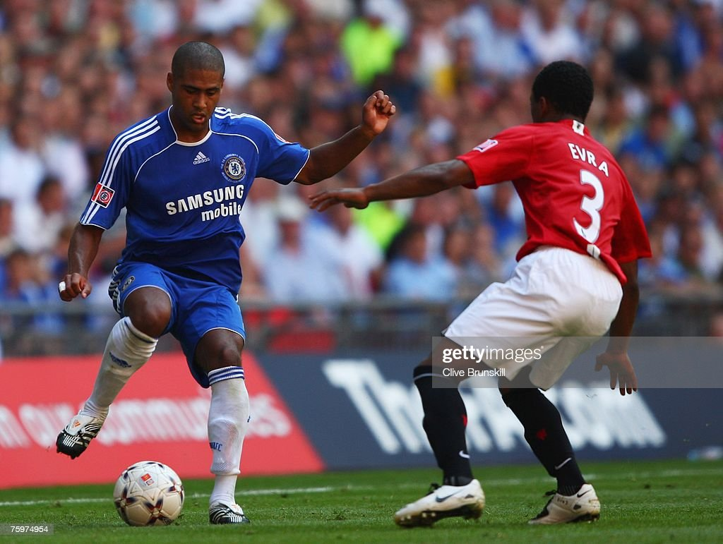 Glen Johnson of Chelsea is watched by Patrice Evra of Manchester United during the FA Community Shield match between Chelsea and Manchester United at Wembley Stadium on August 5, 2007 in London,England.