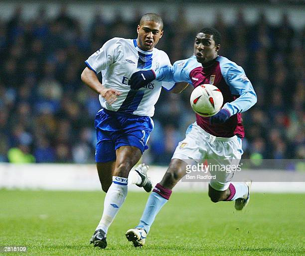 Glen Johnson of Chelsea tackles Jlloyd Samuel of Aston Villa during the Carling Cup Quarter Final match between Aston Villa and Chelsea at Villa Park...