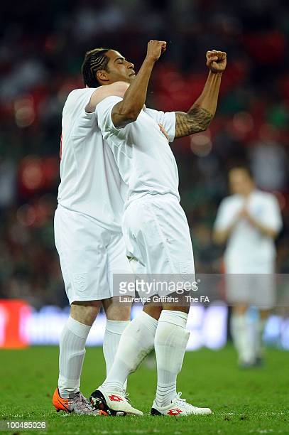 Glen Johnson of England shoots and scores the third goal of the game and is congratulated by team mate Wayne Rooney during the International Friendly...