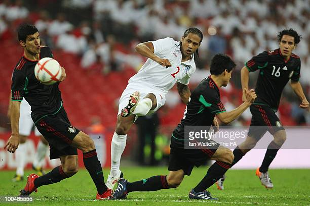 Glen Johnson of England shoots to score his sides third goal during the International Friendly match between England and Mexico at Wembley Stadium on...