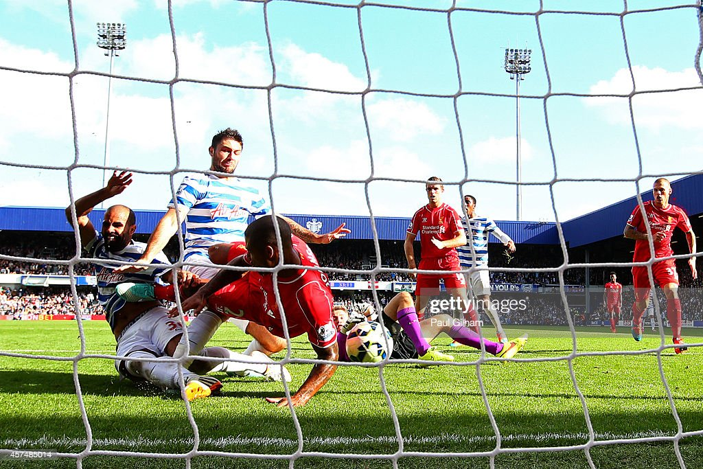 Glen Johnson of Liverpool blocks an attempt from Sandro and Charlie Austin of QPR during the Barclays Premier League match between Queens Park Rangers and Liverpool at Loftus Road on October 19, 2014 in London, England.