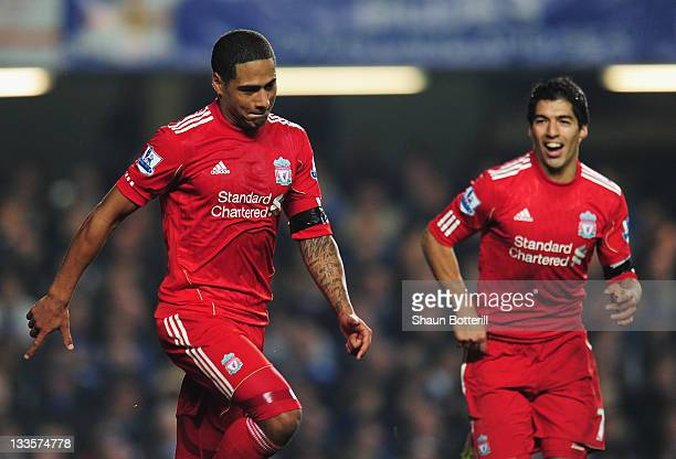 Glen Johnson of Liverpool celebrates his goal with Luis Suarez during the Barclays Premier League match between Chelsea and Liverpool at Stamford...