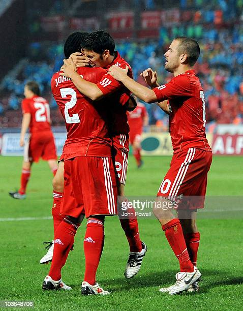 Glen Johnson of Liverpool celebrates with team mates Dani Pacheco and Joe Cole after Remzi Griay Karcar of Trabzonspor scored an own goal during the...