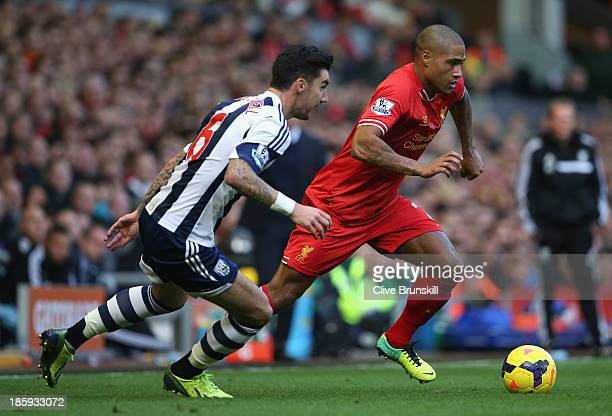 Glen Johnson of Liverpool competes with Liam Ridgewell of West Bromwich Albion during the Barclays Premier League match between Liverpool and West...