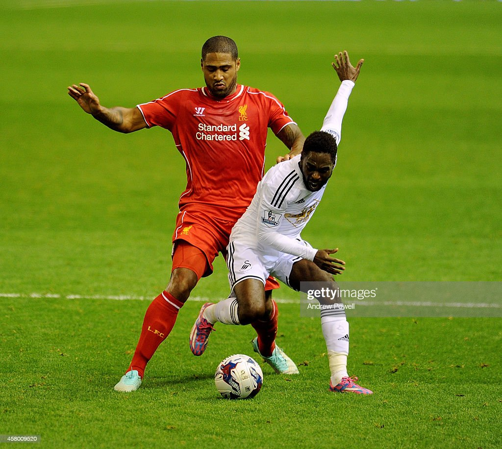 Glen Johnson of Liverpool competes with Nathan Dyer of Swansea City during the Capital One Cup Fourth Round match between Liverpool and Swansea City at Anfield on October 28, 2014 in Liverpool, England.
