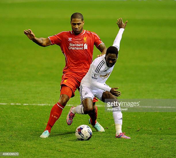 Glen Johnson of Liverpool competes with Nathan Dyer of Swansea City during the Capital One Cup Fourth Round match between Liverpool and Swansea City...