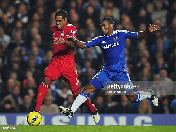 Glen Johnson of Liverpool goes past Florent Malouda of Chelsea on his way to scoring during the Barclays Premier League match between Chelsea and...