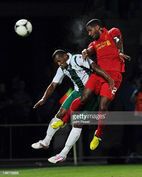 Glen Johnson of Liverpool in action with Aluhona Alexander of FC Gomel during the UEFA Europa League Qualifying, Third Round, First Leg match between...