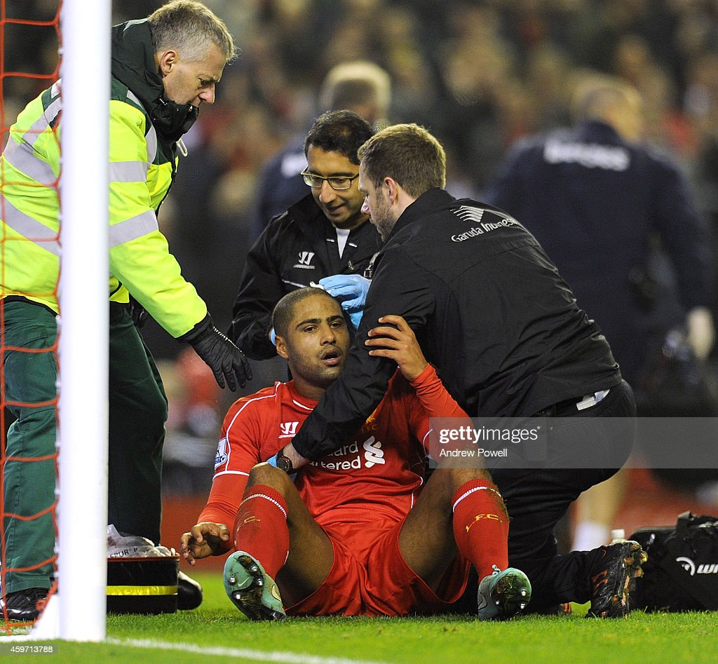Glen Johnson of Liverpool recieves treatment for a head injury after scoring his goal during the Barclays Premier Leauge match between Liverpool and Stoke City at Anfield on November 29, 2014 in Liverpool, England.