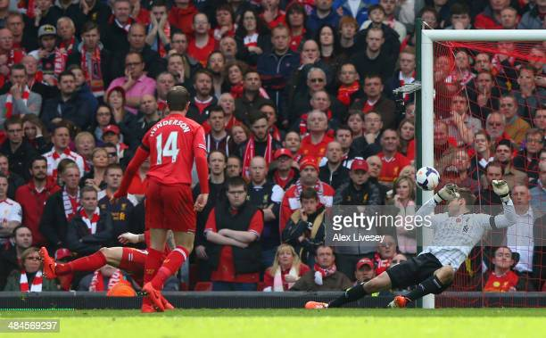 Glen Johnson of Liverpool scores an own goal during the Barclays Premier League match between Liverpool and Manchester City at Anfield on April 13...