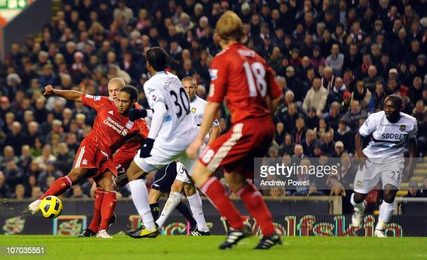 Glen Johnson of Liverpool scores the first goal during the Barclays Premier League match between Liverpool and West Ham United at Anfield on November...