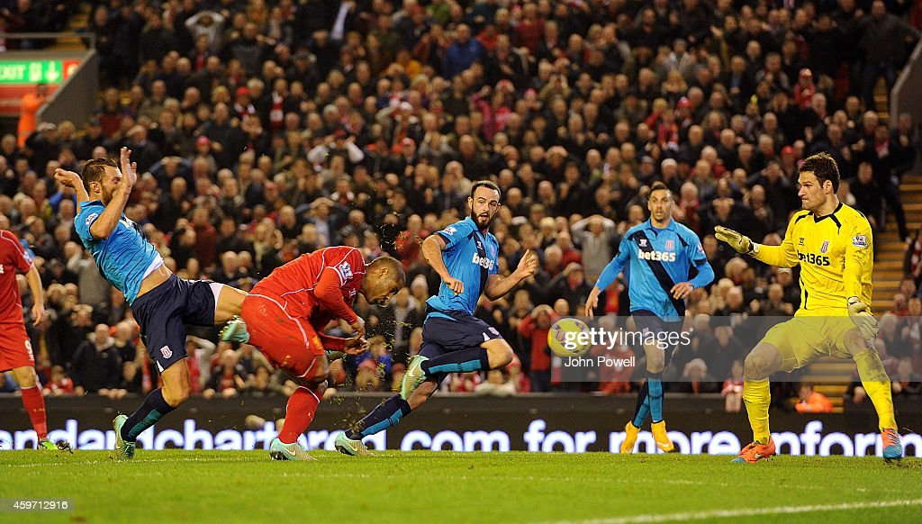 Glen Johnson of Liverpool scores to make it 1-0 during the Barclays Premier Leauge match between Liverpool and Stoke City at Anfield on November 29, 2014 in Liverpool, England.
