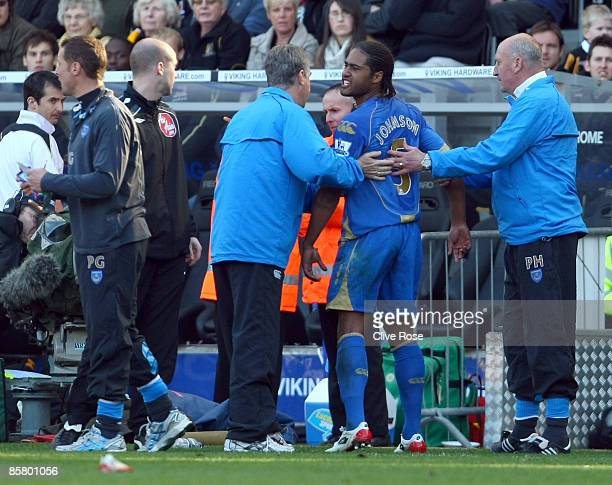 Glen Johnson of Portsmouth argues with the fourth official after being sent off during the Barclays Premier League match between Hull City and...