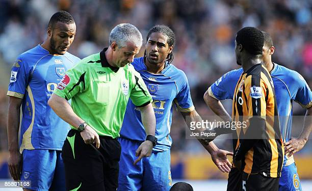 Glen Johnson of Portsmouth is sent off by referee Chris Foy during the Barclays Premier League match between Hull and Portsmouth at The Kingston...