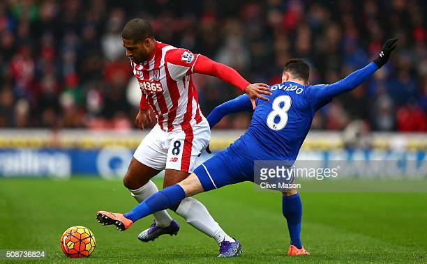 Glen Johnson of Stoke City and Bryan Oviedo of Everton compete for the ball during the Barclays Premier League match between Stoke City and Everton...