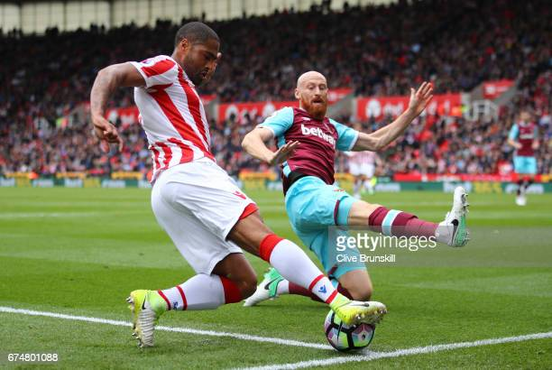 Glen Johnson of Stoke City is closed down by James Collins of West Ham United during the Premier League match between Stoke City and West Ham United...