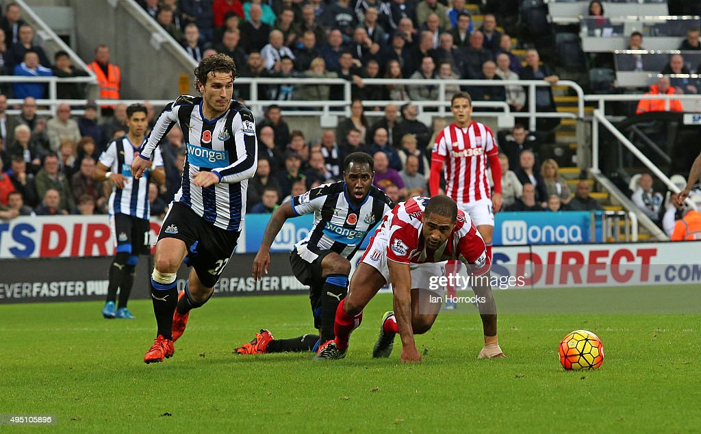 Glen Johnson of Stoke (R) has his shot blocked during the Barclays Premier League match between Newcastle United and Stoke City at St James' Park on October 31, 2015 in Newcastle upon Tyne, England.