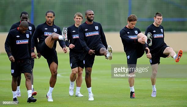 Glen Johnson, Steven Warnock, Darren Bent, Scott Parker and James Milner warm up during an England training session on May 19, 2010 in Irdning,...