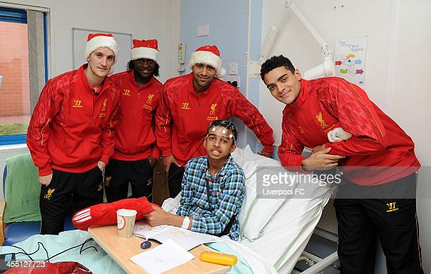 Glen Johnson Tiago Ilori Victor Moses and Luis Alberto of Liverpool FC visits patients at Alder Hey Children's Hospital on December 11 2013 in...