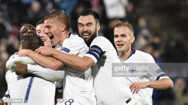 Glen Kamara of Finland celebrates scoring with his team-mates during the UEFA Nations League group stage football match Finland v Grece in Tampere,...