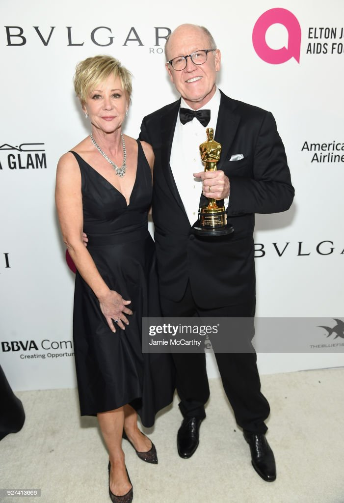 Glen Keane, winner of Best Animated Short Film, (R) and guest attend the 26th annual Elton John AIDS Foundation Academy Awards Viewing Party sponsored by Bulgari, celebrating EJAF and the 90th Academy Awards at The City of West Hollywood Park on March 4, 2018 in West Hollywood, California.