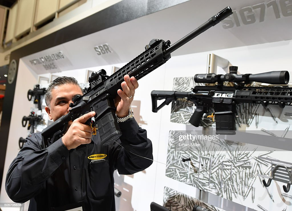 Glen Kukula checks out a Patrol SIG716 rifle by Sig Sauer at the 2016 National Shooting Sports Foundation's Shooting, Hunting, Outdoor Trade (SHOT) Show at the Sands Expo and Convention Center on January 19, 2016 in Las Vegas, Nevada. The SHOT Show, the world's largest annual trade show for shooting, hunting and law enforcement professionals, runs through January 23 and is expected to feature 1,600 exhibitors showing off their latest products and services to more than 62,000 attendees.