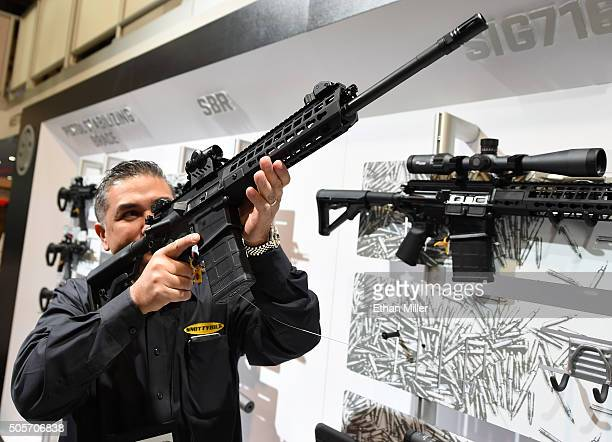 Glen Kukula checks out a Patrol SIG716 rifle by Sig Sauer at the 2016 National Shooting Sports Foundation's Shooting Hunting Outdoor Trade Show at...