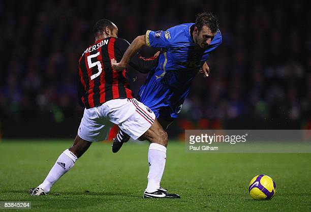 Glen Little of Portsmouth is challenged by Emerson of AC Milan during the UEFA Cup Group E match between Portsmouth and AC Milan at Fratton Park on...