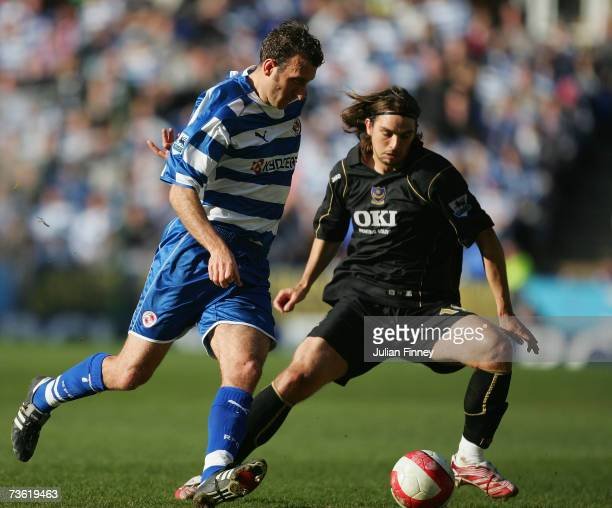 Glen Little of Reading battles with Niko Kranjcar of Portsmouth during the Barclays Premiership match between Reading and Portsmouth at the Madejski...