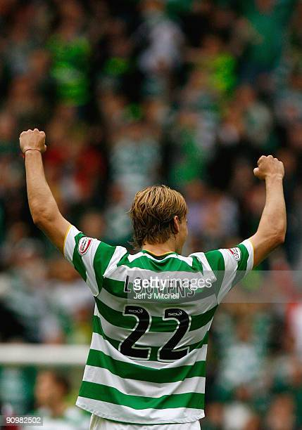 Glen Loovens of Celtic celebrates at the end of the Clydesdale Bank Scottish Premier league match between Celtic and Hearts at Celtic Park on...