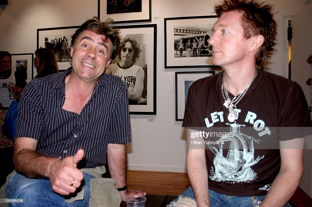 Glen Matlock of the Sex Pistols and Keanan Dufty during Bob Gruen Print Sale Benefiting the Joey Ramone Foundation at Morrison Hotel Gallery Loft in New York, New York, United States.