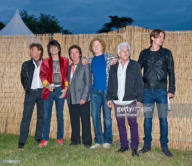 Glen Matlock Ronnie Wood Kenney Jones Mick Hucknall and Ian McLagan of The Faces pose backstage during the second day of Cornbury Festival on July 2...