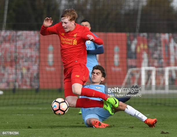 Glen McAuley of Liverpool and Iker Pozo La Rosa of Manchester City in action during the U18 Premier League match between Liverpool and Manchester...