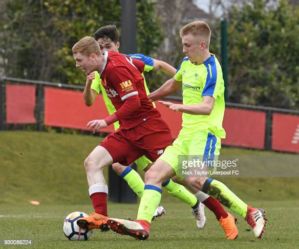 Glen McAuley of Liverpool and Louie Sibley of Derby County in action during the U18 Premier League match between Liverpool and Derby County at The...